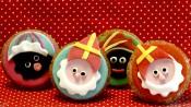 Twee Sinterklaas- en twee Zwartepietcupcakes